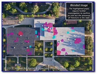 Blended visible and infrared images of a flat roof outlining areas where moisture problems may exist.