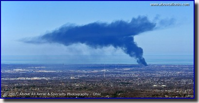 Aerial photo of smoke rising and dispersing from a large fire west of Cleveland, OH
