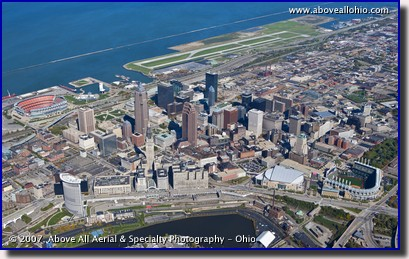 A wide angle oblique aerial view of downtown Cleveland, Ohio, Burke Lakefront Airport, and Lake Erie