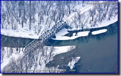 Aerial photo of a snowy train tressel bridge over a river in Pennsylvania
