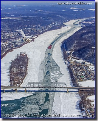 An aerial view of a barge coming down an icy Ohio River in East Liverpool, Ohio.