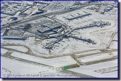 A snowy winter aerial view of the passenger terminal at Cleveland Hopkins International Airport (KCLE), Cleveland, Ohio.