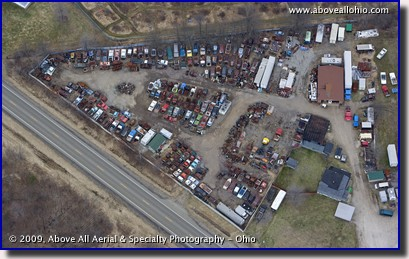 Aerial photo of a junk (salvage) yard with several vintage cars and trucks