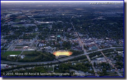 Aerial photograph of Selby Field and the campus of Ohio Wesleyan University at dusk, Delaware, OH