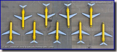 DHL cargo planes are lined up neatly on the ramp at their hub at the Wilmington, Ohio, airport
