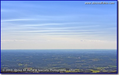 High thin clouds somewhere over Ohio are rippled by upper level winds