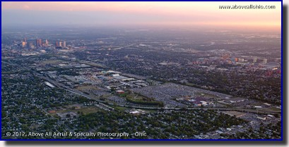 A wide angle aerial panorama of the Ohio State Fair (just left of center in this photo) at sunset. Downtown Columbus, The Ohio State Univerty, and the Columbus Crew stadium are all visible.