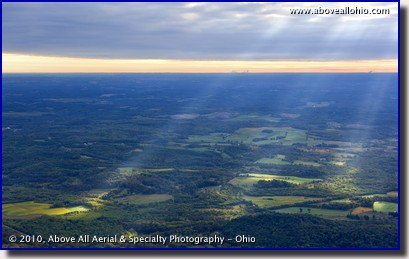 Aerial photograph of sunbeams breaking through the clouds early in the morning south of Canton, Ohio